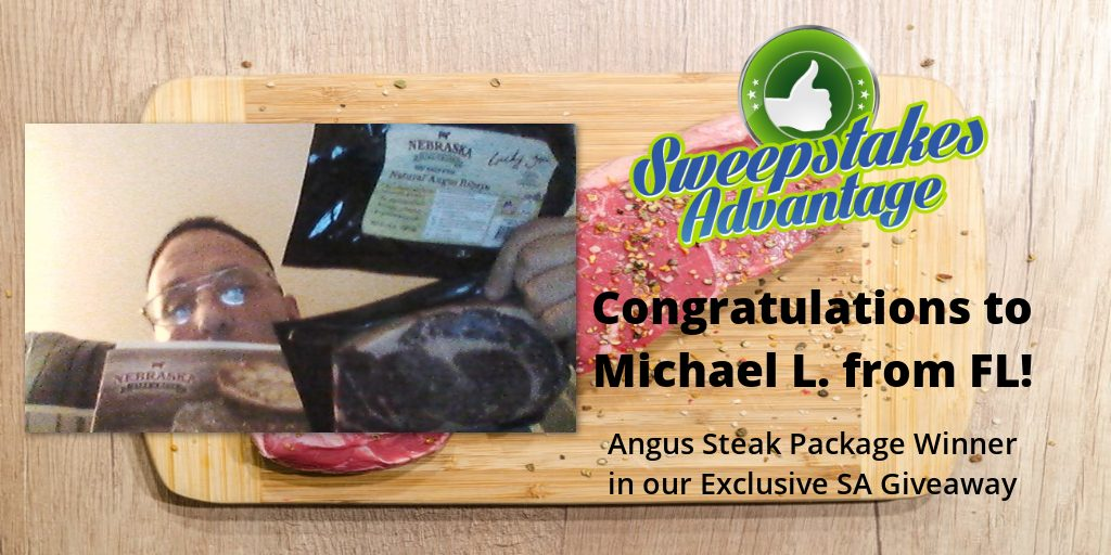 pictiue of Michael holding his steak sweepstakes prize