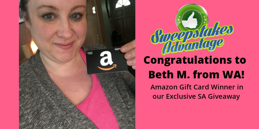 Beth holding gift card prize
