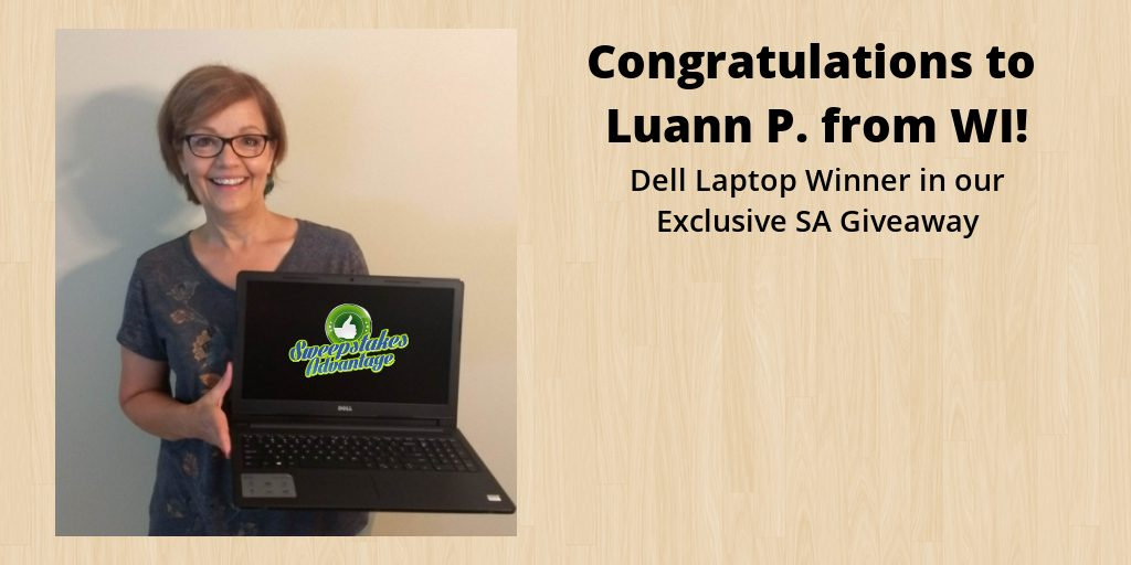 luann holding her new dell laptop prize