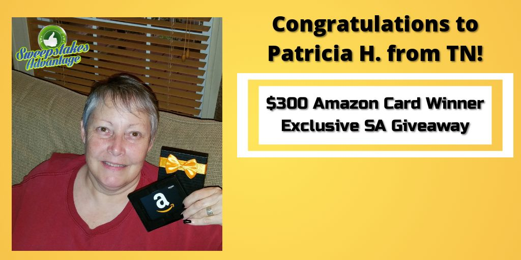 Patricia holding her gift card prize